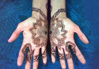 lotus and snakes henna hand design