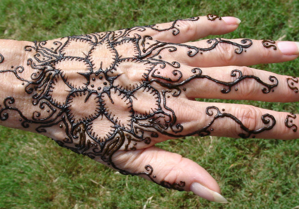 henna lotus design on hand