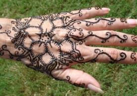 henna lotus design on hand